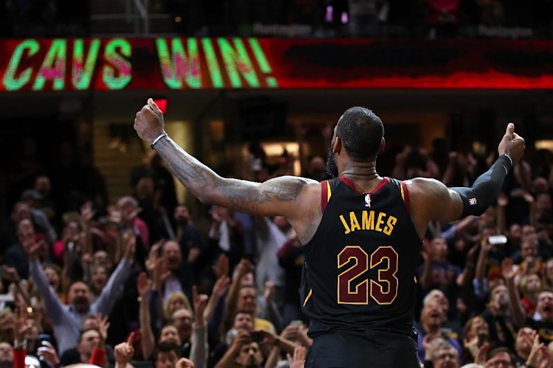 e69575900a62 LeBron James of the Cleveland Cavaliers celebrates after hitting the game  winning shot to beat the