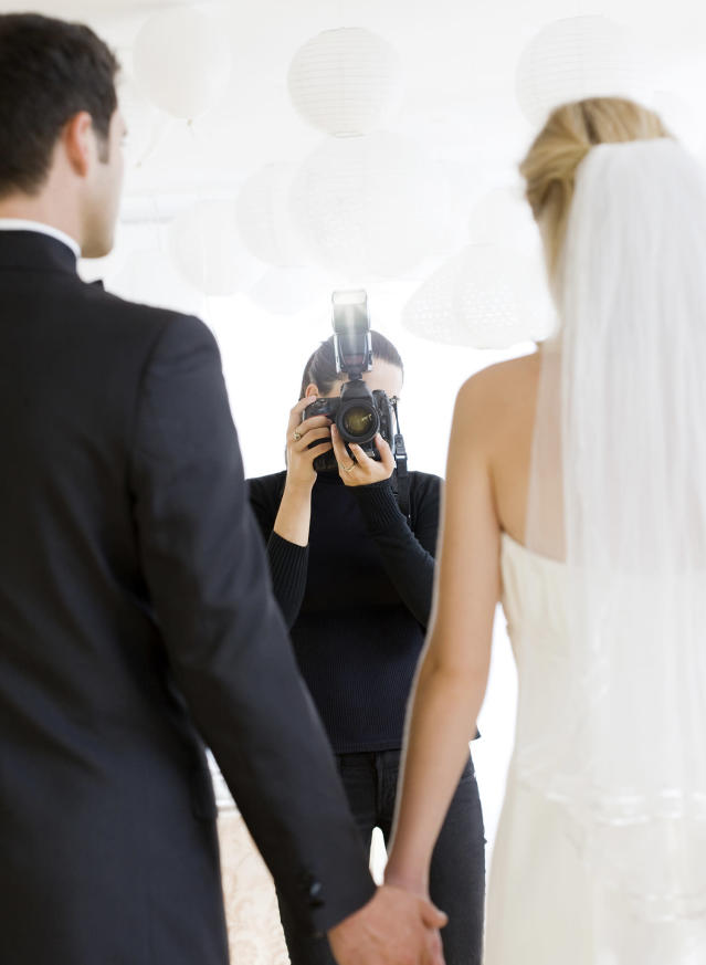 A wedding photographer sued a couple who defamed her on social media — and won a hefty sum. (Photo: Getty Images)