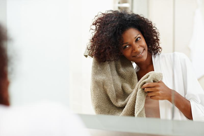 Overwashing can lead to dryness in your hair and scalp. How often you wash your hair depends on your hair type. (GlobalStock via Getty Images)