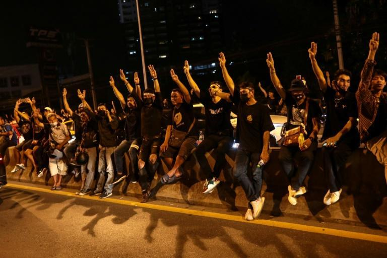 Thai pro-democracy protesters give the three-finger salute during an anti-government rally in Bangkok