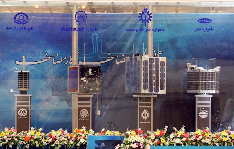 Prototypes for four Iranian home-built satellites (from L) Rasad, Amir Kabir-1, Zafar and Fajr on display during their unveiling ceremony in Tehran on February 7, 2011