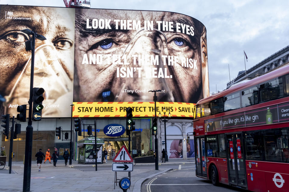 A government NHS (National Heath Service) advert displays the face of a Covid patient, urging Londoners to stay at home and not to take risks or bend the rules during the third lockdown of the Coronavirus pandemic, at Piccadilly Circus in the capital's West End, on 3rd February 2021, in London, England. (Photo by Richard Baker / In Pictures via Getty Images)