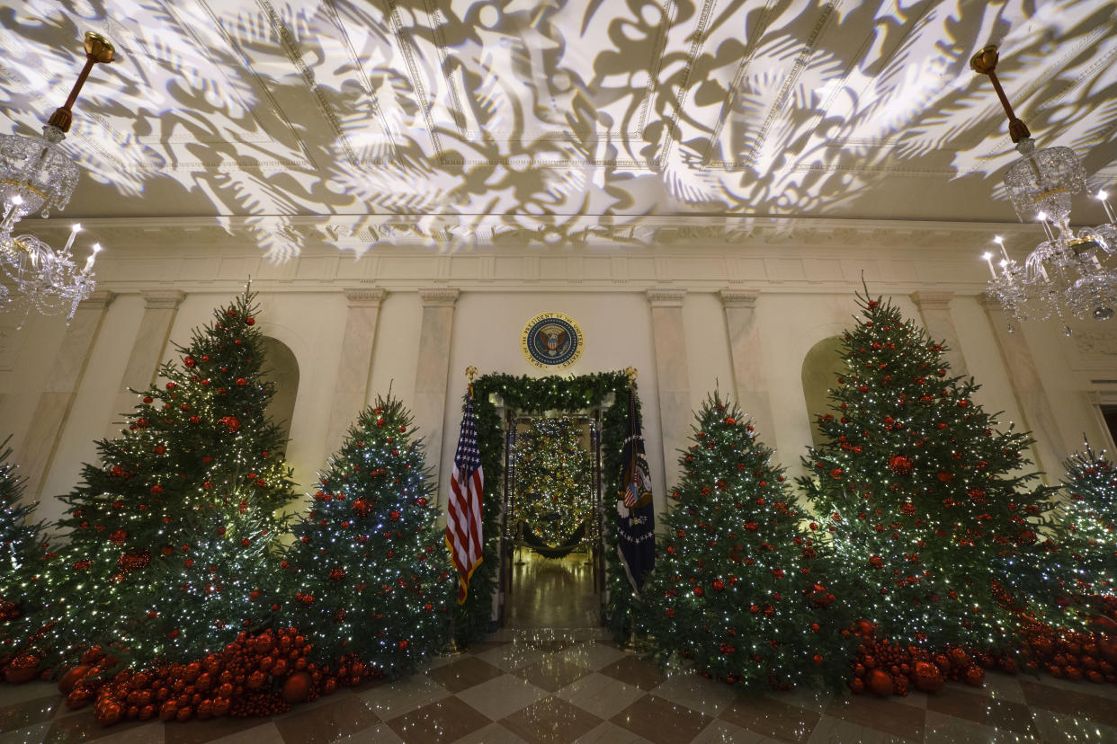 The Grand Foyer and Cross Hall leading into the Blue Room and the official White House Christmas tree are viewed during the 2018 Christmas preview at the White House in Washington, Monday, Nov. 26, 2018. (Photo: Carolyn Kaster/AP)