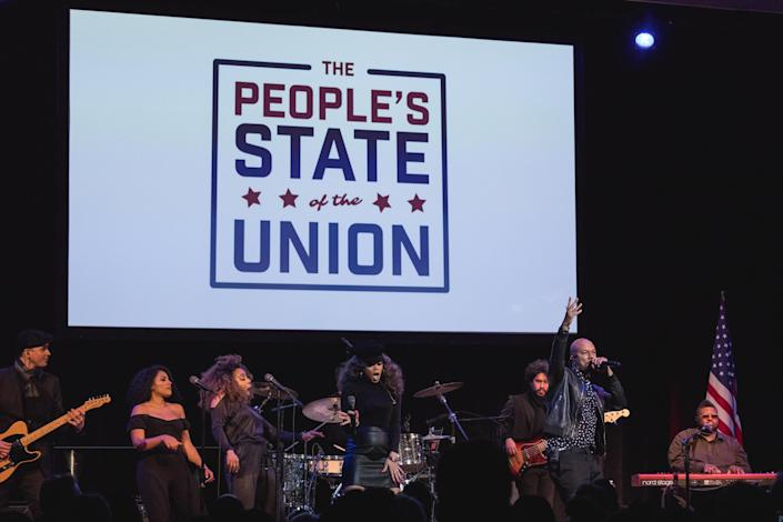 "Andra Day and Common perform their Grammy- and Oscar-nominated song, ""€œStand Up for Something,""€ from the movie ""Marshall"" at the ""People's State of the Union"" rally at the Town Hall theater in New York City on Jan. 29, 2018. (Photo: Cheriss May/NurPhoto)"
