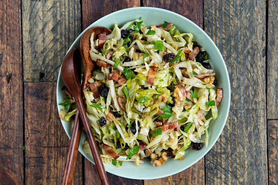 "Pickling and grilling the cabbage for this slaw may seem labor intensive, but the extra work is definitely worth it. Once you try the combination of tangy and smoky flavors, you'll always want to make your slaw this way. <a href=""https://www.epicurious.com/recipes/food/views/tangy-grilled-cabbage-slaw-with-raisins-and-walnuts-56389814?mbid=synd_yahoo_rss"" rel=""nofollow noopener"" target=""_blank"" data-ylk=""slk:See recipe."" class=""link rapid-noclick-resp"">See recipe.</a>"