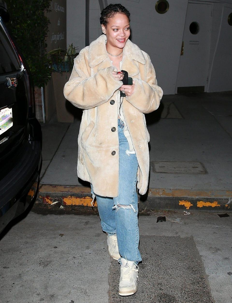 <p>Rihanna leaves dinner at Giorgio Baldi in Santa Monica on Wednesday, wearing a long coat, ripped jeans and sneakers.</p>