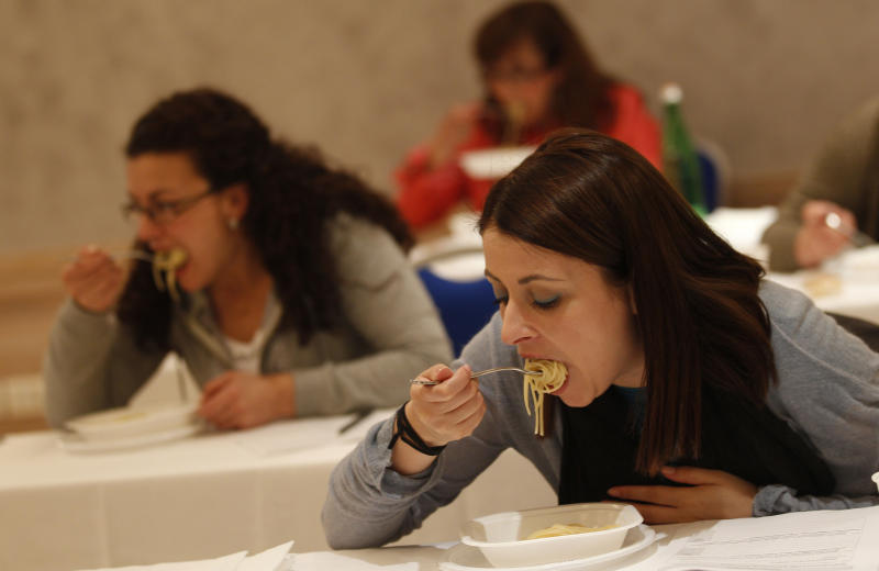 A group of women taste pasta in a hotel conference room in Rome, Friday, May 18, 2012. Pasta sales worldwide have grown steadily over the past three years. Pasta is serious business in Italy, and a recent blind taste test organized by the world's biggest pasta maker, Barilla, drove home that an awful lot of thought goes into making the simple combination of durum wheat semolina and water from which Italy's national dish is made. (AP Photo/Alessandra Tarantino)