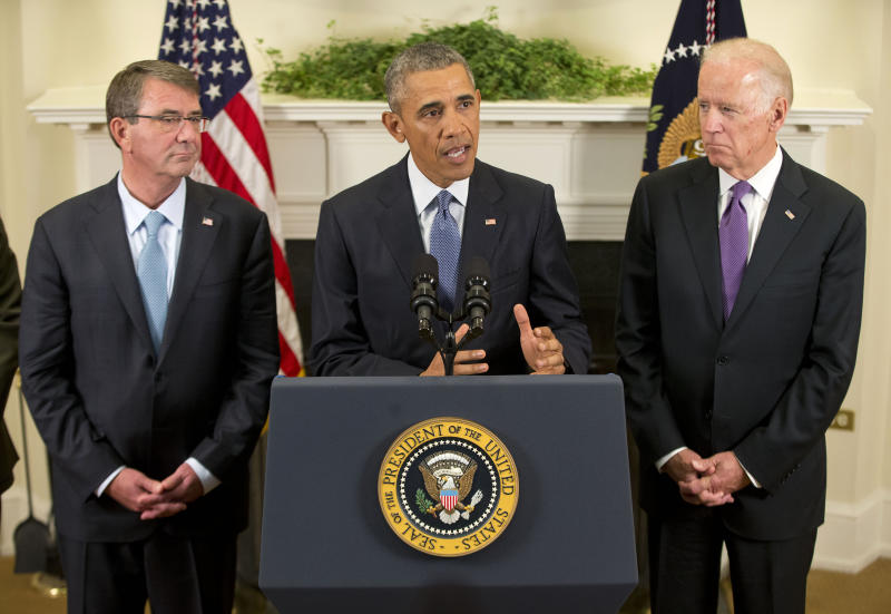 President Barack Obama, flanked by Vice President Joe Biden, right, and Defense Secretary Ash Carter, speaks about Afghanistan on Oct. 15, 2015, in the Roosevelt Room of the White House in Washington. (Photo: Pablo Martinez Monsivais/AP)