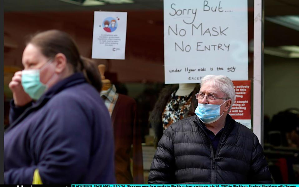 Shoppers wear face masks in Blackburn town centre - Christopher Furlong/Getty Images Europe