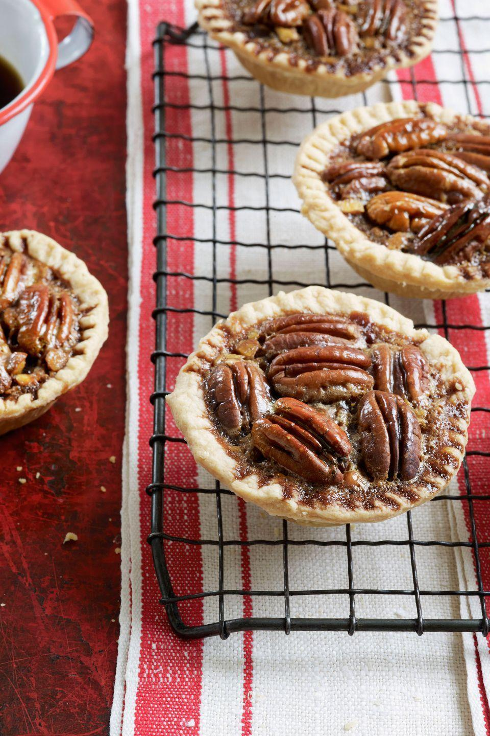 "<p>The rich taste of chocolate and the salty crunch of pecans are squeezed into tiny tarts.</p><p><a href=""https://www.countryliving.com/food-drinks/recipes/a3379/chocolate-pecan-tartlets-recipe-clv0510/"" rel=""nofollow noopener"" target=""_blank"" data-ylk=""slk:Get the recipe."" class=""link rapid-noclick-resp""><strong>Get the recipe.</strong></a></p>"