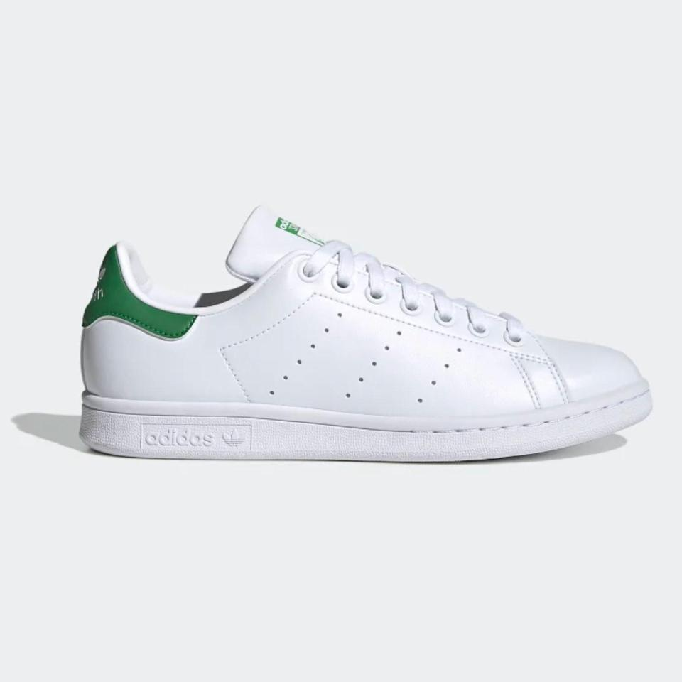 """Adidas has a range of popular white sneakers, from the classic <a href=""""https://www.adidas.com/us/superstar-shoes/FV3284.html"""" rel=""""nofollow noopener"""" target=""""_blank"""" data-ylk=""""slk:three-stripe Superstar"""" class=""""link rapid-noclick-resp"""">three-stripe Superstar</a> to the modern and sporty <a href=""""https://www.adidas.com/us/nmd_r1-shoes/D96635.html"""" rel=""""nofollow noopener"""" target=""""_blank"""" data-ylk=""""slk:NMDs"""" class=""""link rapid-noclick-resp"""">NMDs</a>—but you can't go wrong with a pair of Stan Smiths. They come in so many colors, but you can always fall back on the white-and-green combo of which everyone from <a href=""""https://i.pinimg.com/736x/86/e2/43/86e243c5f8f04dc03ea395e8a8574646.jpg"""" rel=""""nofollow noopener"""" target=""""_blank"""" data-ylk=""""slk:Katie Holmes"""" class=""""link rapid-noclick-resp"""">Katie Holmes</a> to <a href=""""https://www.instagram.com/p/CEJl4UeFGGs/?utm_source=ig_embed"""" rel=""""nofollow noopener"""" target=""""_blank"""" data-ylk=""""slk:Meghan Markle"""" class=""""link rapid-noclick-resp"""">Meghan Markle</a> is a…stan (sorry, had to). $85, Adidas. <a href=""""https://www.adidas.com/us/stan-smith-shoes/Q47226.html"""" rel=""""nofollow noopener"""" target=""""_blank"""" data-ylk=""""slk:Get it now!"""" class=""""link rapid-noclick-resp"""">Get it now!</a>"""