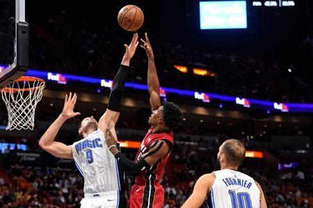 Dec 4, 2018; Miami, FL, USA; Miami Heat guard Josh Richardson (0) shoots the ball over Orlando Magic center Nikola Vucevic (9) during the second half at American Airlines Arena. Mandatory Credit: Jasen Vinlove-USA TODAY Sports