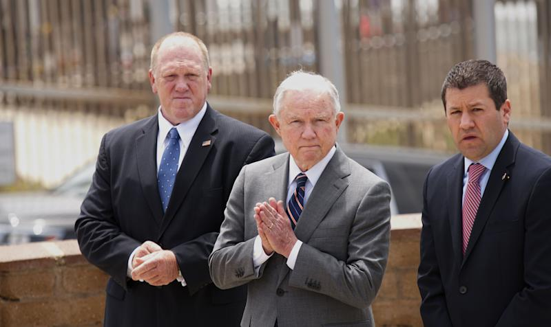 Then-Attorney General Jeff Sessions and Thomas Homan, left, then head of Immigration and Customs Enforcement, hold a news conference May 7, 2018, in San Ysidro, Calif., on the Trump administration's hard-line immigration policy. (Photo: Sandy Huffaker/Getty Images)