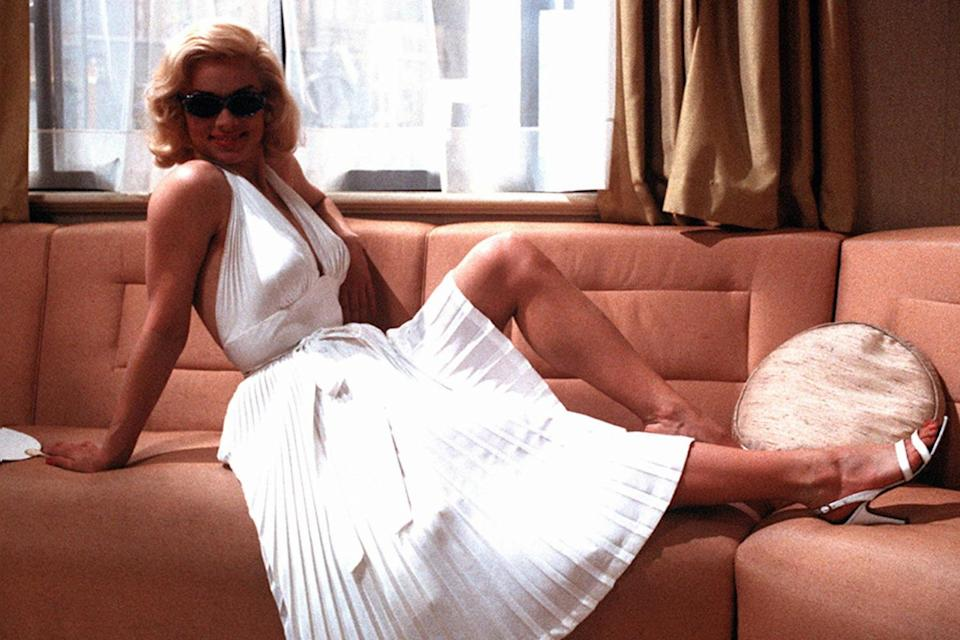 <p>Russell stepping into Monroe's shoes — well, heels — when she played her in the 1985 British film, <em>Insignificance. </em></p>