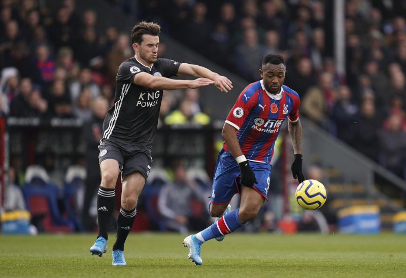 Leicester City's Ben Chilwell, left, and Crystal Palace's Jordan Ayew battle for the ball during the English Premier League soccer match at Selhurst Park, London, Sunday Nov. 3, 2019. (John Walton/PA via AP)