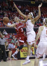 Indiana guard Tyra Buss, left, shoots against Maryland center Brionna Jones in the first half of an NCAA college basketball game, Thursday, Feb. 26, 2015, in College Park, Md. (AP Photo/Patrick Semansky)
