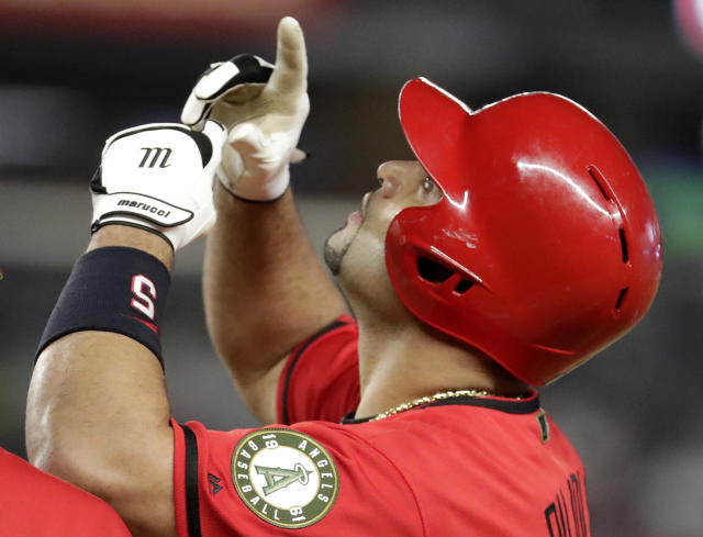 Los Angeles Angels' Albert Pujols gestures after a single off New York Yankees relief pitcher Tommy Kahnle during the sixth inning of a baseball game Saturday, May 26, 2018, in New York. (AP Photo/Julio Cortez)
