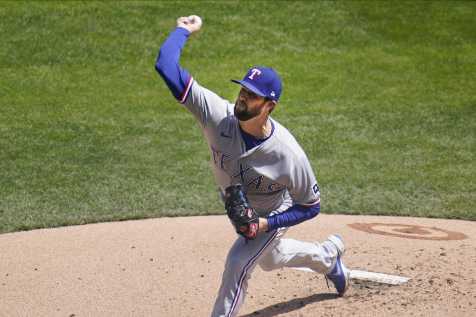 Texas Rangers' pitcher Jordan Lyles throws against the Minnesota Twins in the first inning of a baseball game, Thursday, May 6, 2021, in Minneapolis. (AP Photo/Jim Mone)