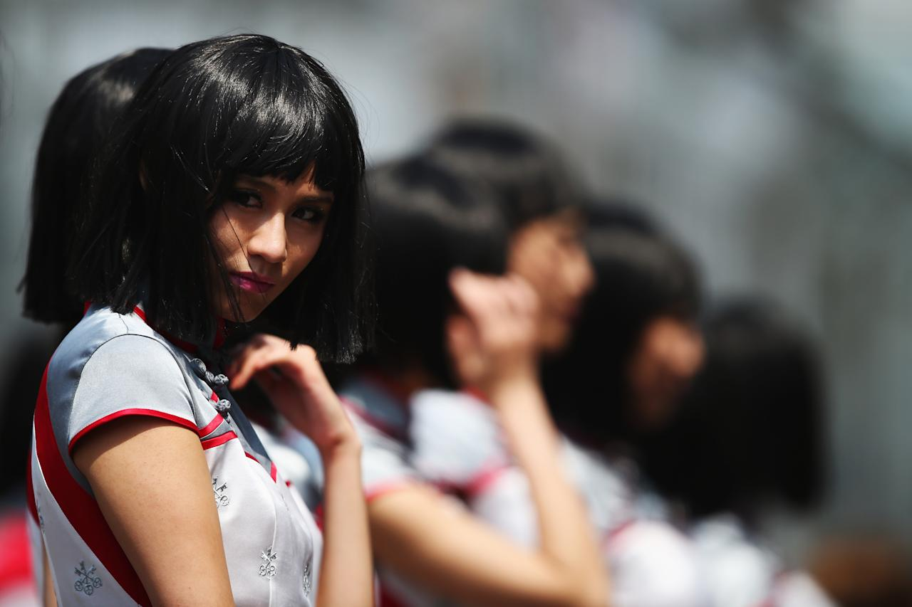SHANGHAI, CHINA - APRIL 14:  Grid girls line up for the drivers parade before the Chinese Formula One Grand Prix at the Shanghai International Circuit on April 14, 2013 in Shanghai, China.  (Photo by Clive Mason/Getty Images)