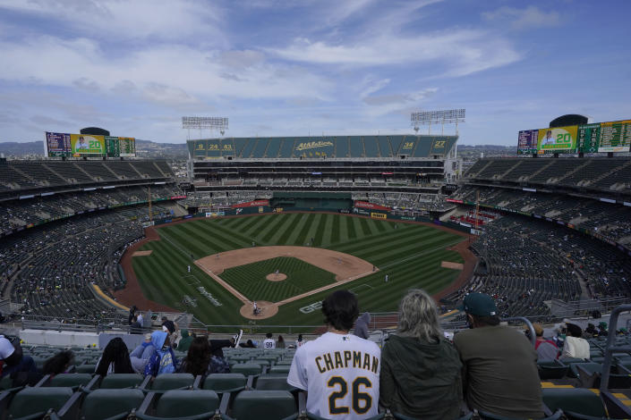 Fans watch during the fifth inning of a baseball game between the Oakland Athletics and the Houston Astros in Oakland, Calif., Saturday, April 3, 2021. (AP Photo/Jeff Chiu)