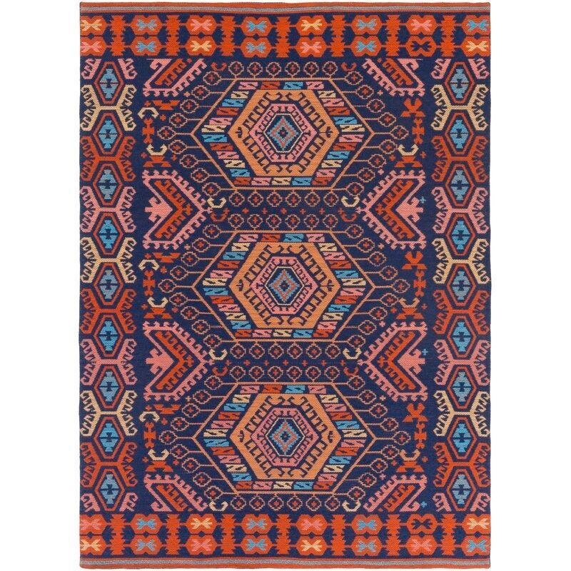"<br><br><strong>Bloomsbury Market</strong> Keeter Southwestern Hand-Woven Flatweave Rug (5' x 7'), $, available at <a href=""https://go.skimresources.com/?id=30283X879131&url=https%3A%2F%2Fwww.wayfair.com%2Frugs%2Fpdp%2Fbloomsbury-market-keeter-southwestern-hand-woven-flatweave-navyburnt-orange-indoor-outdoor-area-rug-blms4494.html%3Fpiid%3D27046216"" rel=""nofollow noopener"" target=""_blank"" data-ylk=""slk:Wayfair"" class=""link rapid-noclick-resp"">Wayfair</a>"