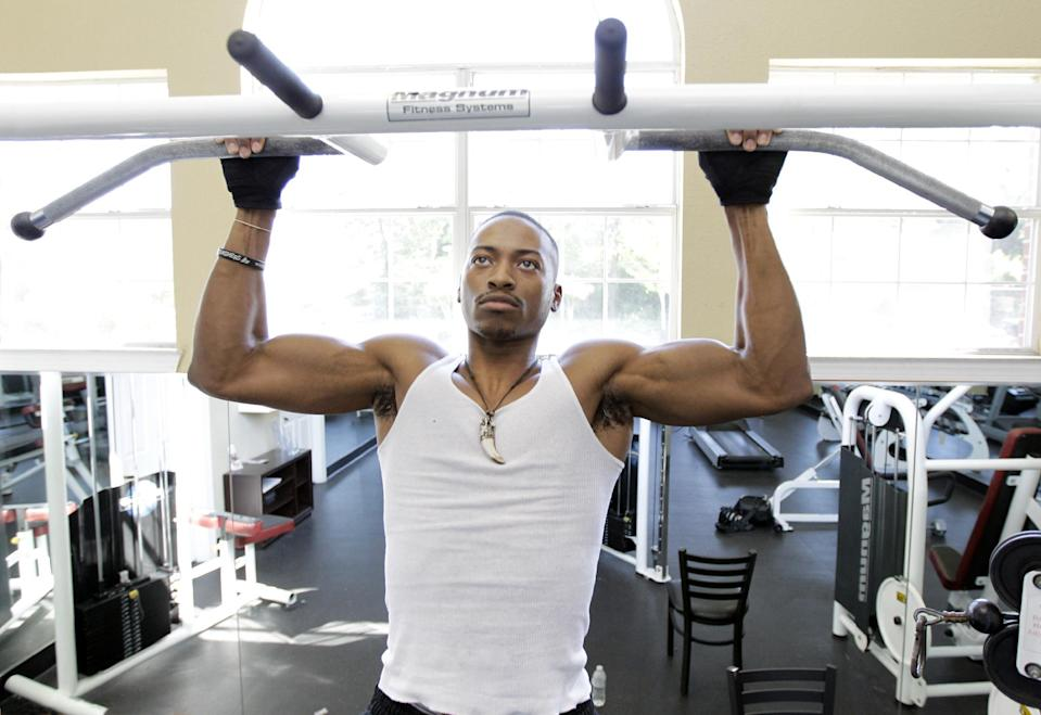 In this photo taken Thursday, April 19, 2012, Kelman Edwards Jr., working out at an apartment complex gym near the campus of Middle Tennessee State University in Murfreesboro,Tenn. The college class of 2012 is in for a rude welcome to the world of work. A weak labor market already has left half of young college grads either jobless or underemployed in positions that don't fully use their skills and knowledge. (AP Photo/Mark Humphrey)