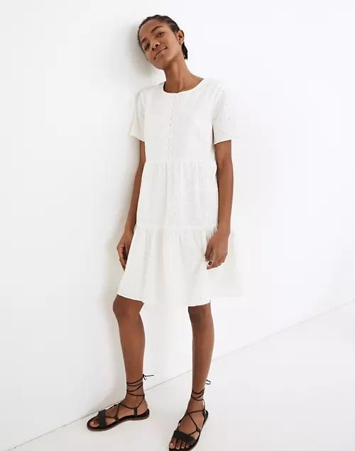<p><span>Embroidered Eyelet Button-Front Tiered Mini Dress</span> ($100, originally $128)</p>