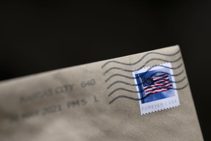 A stamp is shown on an envelope Friday, May 28, 2021, in Washington. The U.S. Postal Service is raising rates on first class stamps from 55 cents to 58 as part of a host of price hikes and service changes designed to reduce debt for the beleaguered agency. The changes, which will take effect on Aug. 29, include price hikes for first class mail, magazines and marketing mailers. (AP Photo/Jenny Kane)