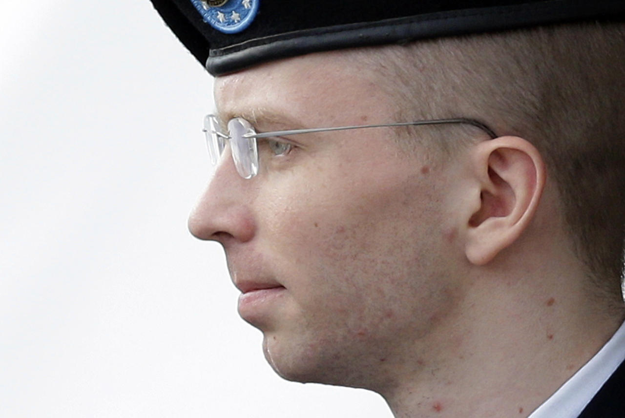 Army Pfc. Bradley Manning is escorted to a security vehicle outside a courthouse in Fort Meade, Md., Tuesday, Aug. 20, 2013, after a hearing in his court martial. A U.S. military judge is expected to announce her sentencing decision Wednesday in Manning's role in leaking classified material to WikiLeaks. (AP Photo/Patrick Semansky)