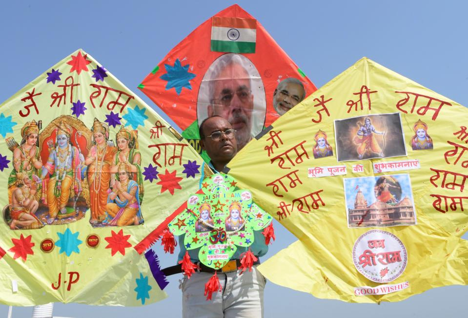 A kite-maker poses with kites decorated with the pictures of Ram Temple, lord Ram Darbar and India's Prime Minister Narendra Modi, in Amritsar on August 4, 2020, a day before the ground-breaking ceremony for the construction of Lord Ram Temple in Ayodhya. - India's Prime Minister Narendra Modi will lay the foundation stone for a grand Hindu temple in a highly anticipated ceremony at a holy site that was bitterly contested by Muslims, officials said. The Supreme Court ruled in November 2019 that a temple could be built in Ayodhya, where Hindu zealots demolished a 460-year-old mosque in 1992. (Photo by Narinder NANU / AFP) (Photo by NARINDER NANU/AFP via Getty Images)