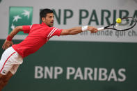 Serbia's Novak Djokovic stretches to return the ball to Italy's Matteo Berrettini during their quarterfinal match of the French Open tennis tournament at the Roland Garros stadium Wednesday, June 9, 2021 in Paris. (AP Photo/Michel Euler)