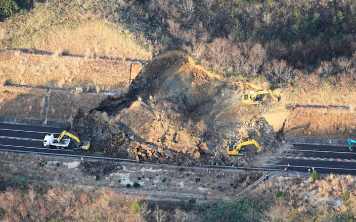 A portion of a highway is blocked by a landslide - Kyodo News