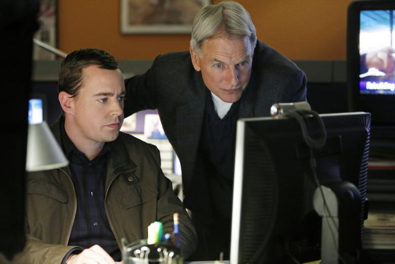 """This undated publicity image released by CBS shows Sean Murray, left, and Mark Harmon in a scene from """"NCIS,"""" a long-running series that was one of 18 series renewed by CBS on Wednesday, March 27, 2013. (AP Photo/CBS, Cliff Lipson)"""