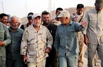 Head of the Badr Organisation and Shi'ite paramilitary commander Hadi al-Amiri (C) walks with Shi'ite fighters at Lake Tharthar, west of Samarra, Iraq in this June 6, 2015 file photo. REUTERS/Stringer/Files