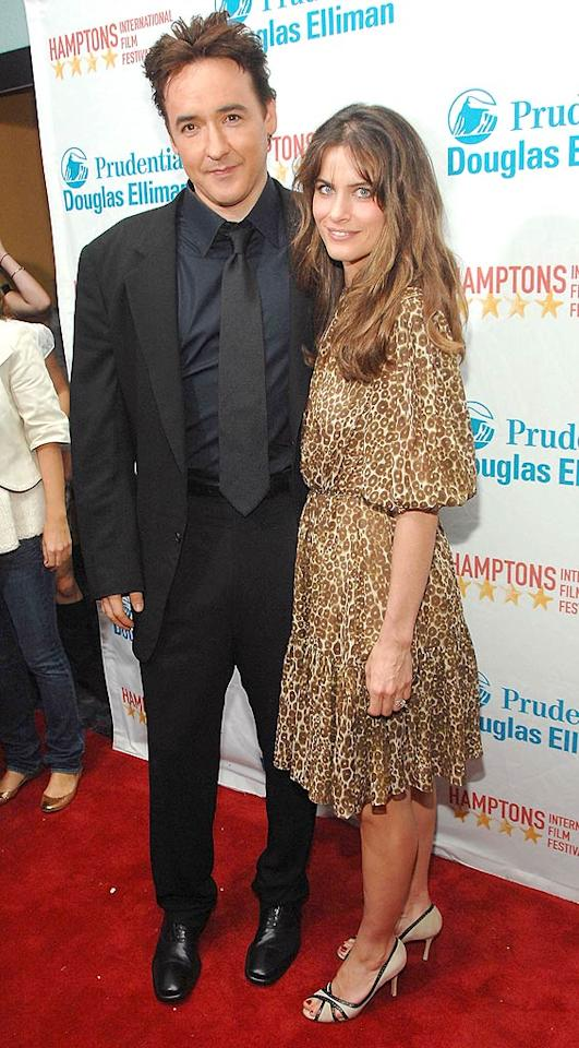 """After starring together in """"Identity"""" and """"Martian Child,"""" best buds John Cusack and Amanda Peet have re-teamed for the upcoming disaster film """"2012."""" Jason Kempin/<a href=""""http://www.wireimage.com"""" target=""""new"""">WireImage.com</a> - October 19, 2007"""