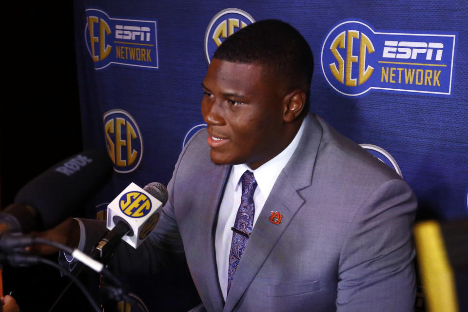 FILE - In this July 18, 2019, file photo, Auburn defensive tackle Derrick Brown speaks to reporters during the NCAA college football Southeastern Conference Media Days, in Hoover, Ala. Brown was selected the SEC defensive player of the year on The Associated Press All-Southeastern Conference football team, Monday, Dec. 9, 2019. (AP Photo/Butch Dill, File)