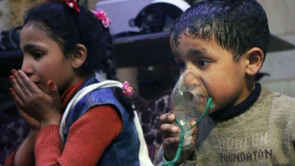 PHOTO: This image released early Sunday, April 8, 2018 by the Syrian Civil Defense White Helmets, shows a child receiving oxygen through respirators following an alleged poison gas attack in the rebel-held town of Douma, near Damascus, Syria. (Syrian Civil Defense White Helmets via AP)