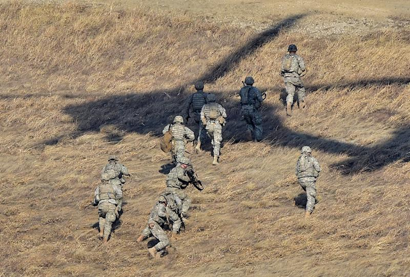 US soldiers move from their drop-off point after exiting a US Army UH-60 Black Hawk helicopter during a live-fire drill in Pocheon, north of Seoul, in March 2015 (AFP Photo/Jung Yeon-Je)