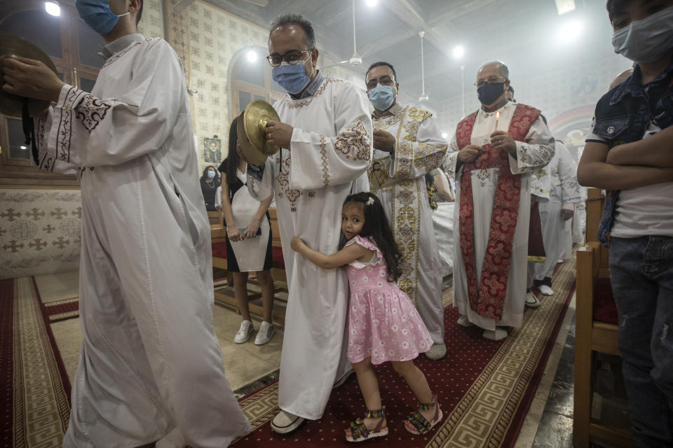 Coptic Orthodox deacon pray during Easter mass, at Holy Cross Church in Cairo, Egypt, Saturday, May 1, 2021. Orthodox Christians around the world celebrate Easter on Sunday, May 2. (AP Photo/Nariman El-Mofty)