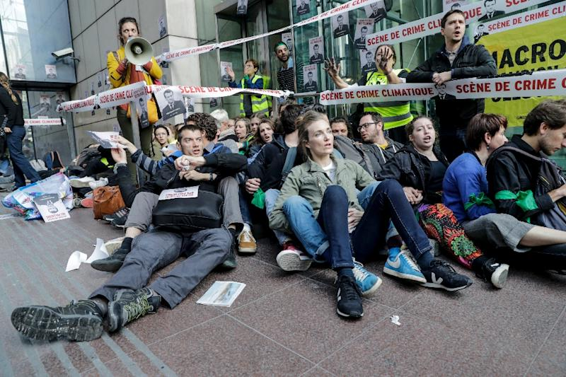 Environmental activists tried to block access to to the headquarters of energy giant Total, electricity firm EDF and bank Societe Generale (AFP Photo/Thomas SAMSON)