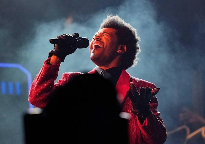 FILE - The Weeknd performs during the halftime show of the NFL Super Bowl 55 football game on Feb. 7, 2021, in Tampa, Fla. (AP Photo/David J. Phillip, File)
