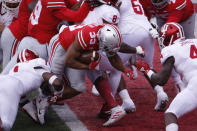 Ohio State running back Master Teague, center, pushes into the end zone for a touchdown against Indiana during the first half of an NCAA college football game Saturday, Nov. 21, 2020, in Columbus, Ohio. (AP Photo/Jay LaPrete)