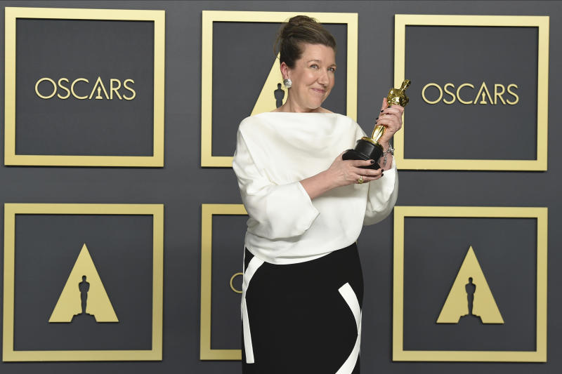 "Jacqueline Durran, winner of the award for best costume design for ""Little Women"", poses in the press room at the Oscars on Sunday, Feb. 9, 2020, at the Dolby Theatre in Los Angeles. (Photo by Jordan Strauss/Invision/AP)"