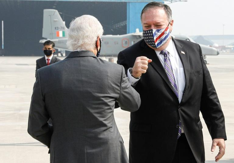 US Secretary of State Mike Pompeo is greeted by US Ambassador to India Kenneth Juster upon his arrival at an airport in New Delhi