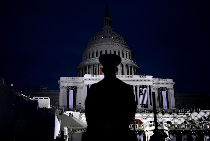 <p>A U.S. Marine stands on the West Front of the U.S. Capitol on January 20, 2017 in Washington. (Photo: Joe Raedle/Getty Images) </p>