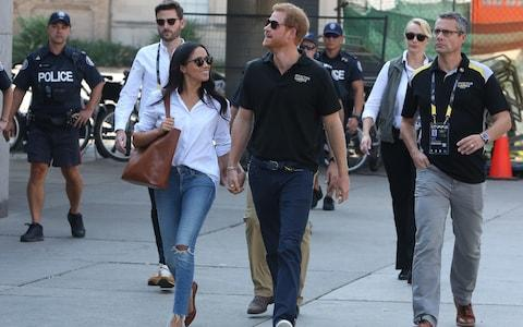 Prince Harry and Meghan Markle attend the Tennis together at the Invictus Games in Toronto - Credit: Splash News