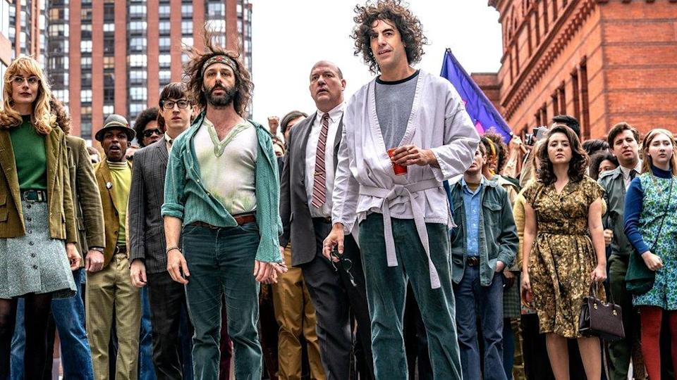 Jeremy Strong and Sacha Baron Cohen with other cast members of The Trial of the Chicago 7