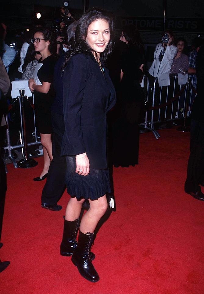Golden Globe winner Catherine Zeta-Jones usually goes for heels and elegant gowns now. In 1997, she paired lace-up boots with a schoolgirl-style suit for one of her first red carpet appearances.