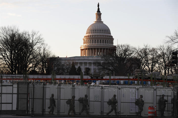 National Guards deploy inside the security perimeter surrounding the Capitol ahead of President-elect Joe Biden's inauguration ceremony, Tuesday, Jan. 19, 2021, in Washington. (AP Photo/Rebecca Blackwell)