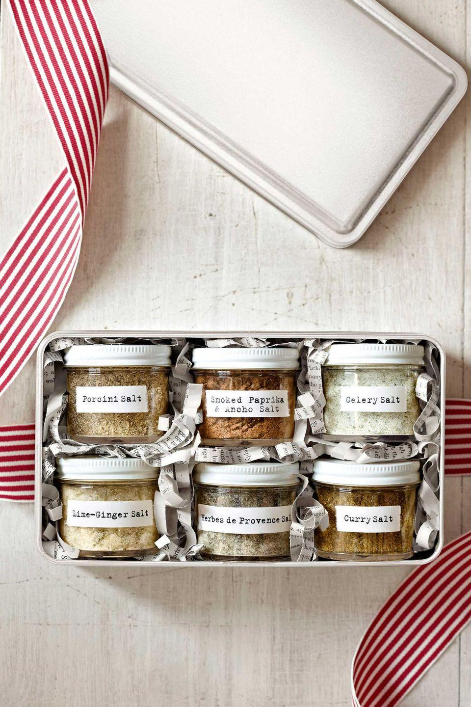 """<p>If the recipient's more of a savory person, make an assortment of salts for a <a href=""""https://www.countryliving.com/food-drinks/g1059/homemade-food-gifts/"""" rel=""""nofollow noopener"""" target=""""_blank"""" data-ylk=""""slk:food gift"""" class=""""link rapid-noclick-resp"""">food gift</a> with some kick. Bottle in jars, stick on our cute labels, and place in a metal box with shredded newspaper for padding.</p><p><strong><a href=""""https://www.countryliving.com/food-drinks/recipes/a4215/flavored-salts-recipe-clv1212/"""" rel=""""nofollow noopener"""" target=""""_blank"""" data-ylk=""""slk:Get the recipe"""" class=""""link rapid-noclick-resp"""">Get the recipe</a>.</strong></p><p><strong><a class=""""link rapid-noclick-resp"""" href=""""https://www.amazon.com/Clear-Plastic-Jar-White-Balm/dp/B00FFM5JZ4/?tag=syn-yahoo-20&ascsubtag=%5Bartid%7C10050.g.645%5Bsrc%7Cyahoo-us"""" rel=""""nofollow noopener"""" target=""""_blank"""" data-ylk=""""slk:SHOP JARS"""">SHOP JARS</a><br></strong></p>"""